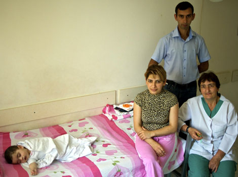 Resting patient and his family after having his cleft lip repaired. Sara Anjargolian